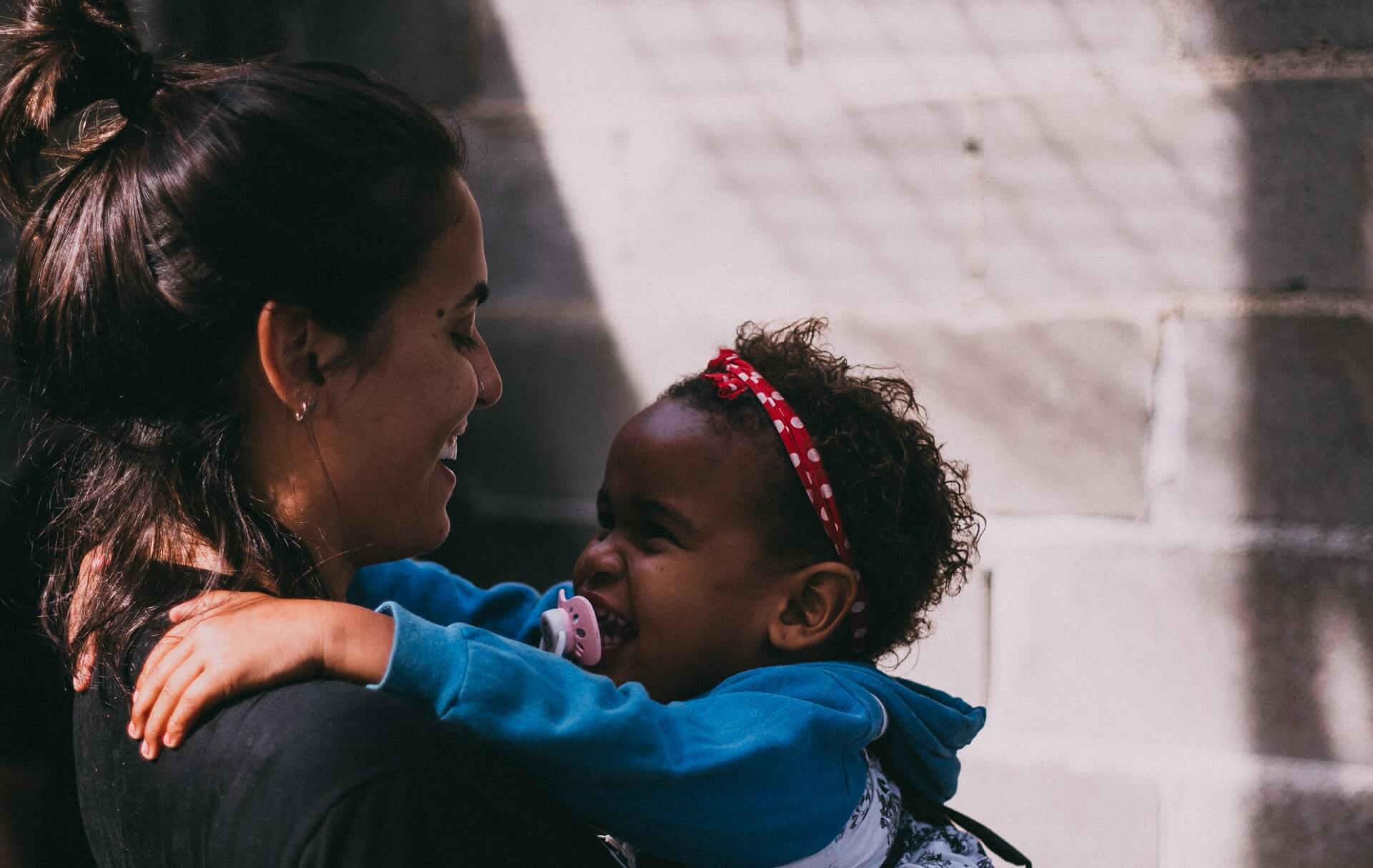 Women and young girl showing affectionate care