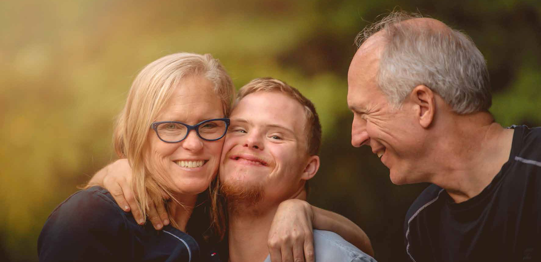 Couple smiling at foster son